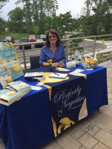 Author Linda Carvelli signing books