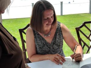 """Lynne Heinzmann signing copies of """"Frozen Voices"""""""
