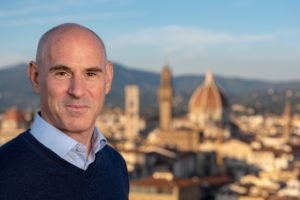 Headshot of Joshua Dick with Florence, Italy in the background. Joshua Dick is the author of Grow Like a Lobster. In this interview he shares insights on how to write a business book.