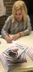 Tamara Kolton signing copies of Oranges for Eve