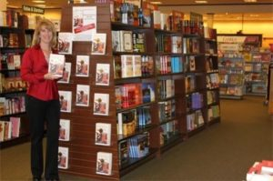 Jill Grimes, MD, with her book Seductive Delusions on the bookstore shelves